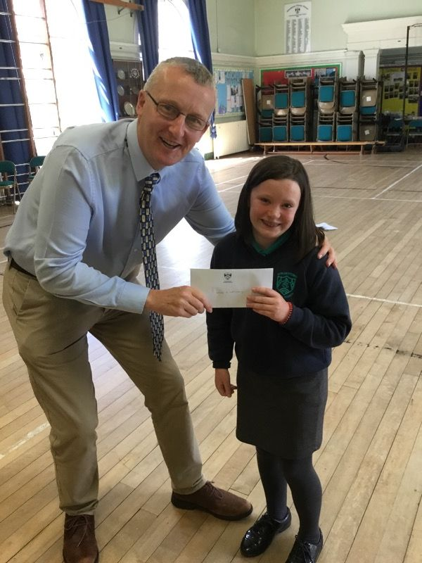 Generous cheque donated to Mr. Ewart which a Y7 pupils collected for school resources.